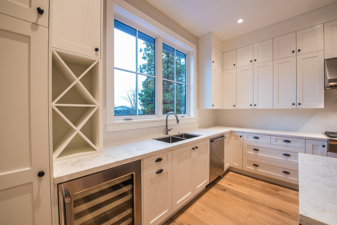 Kitchen with casement window overlooking the back yard.