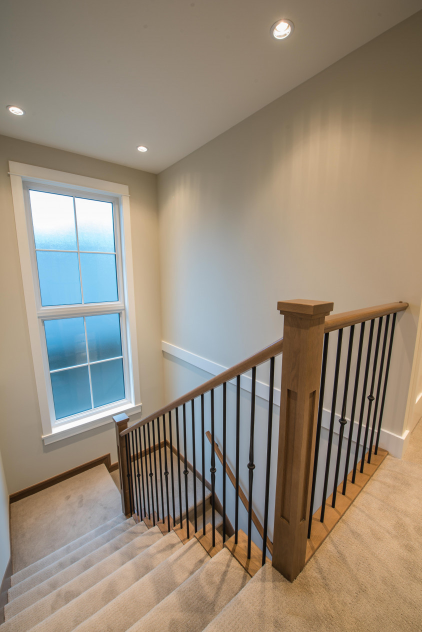 Vinyltek window introduces tons of natural light to this staircase